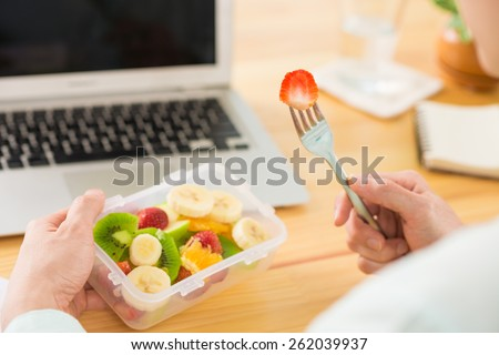 Man eating fruit salad