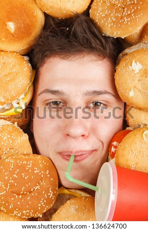 man eating hamburger - stock photo