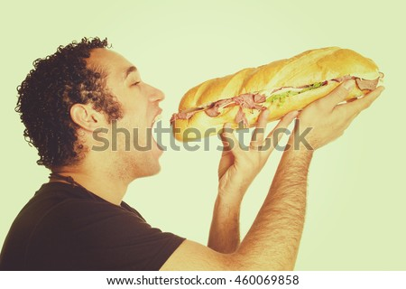 Man eating large sandwich