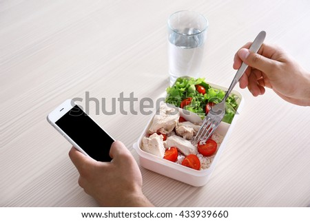 Man eating salad in the kitchen