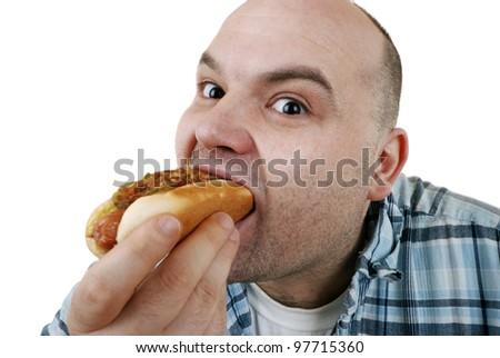 man eats a hot dog - stock photo