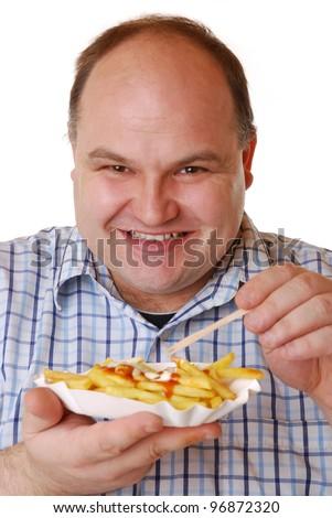 man eats french fries - stock photo