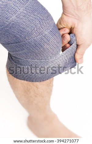 man elastic bandage on knee