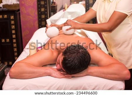 man engaged in Ayurvedic spa treatment - stock photo