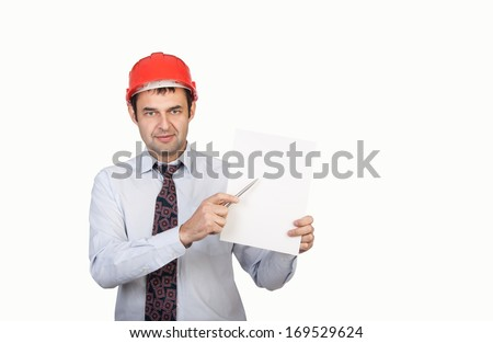 man engineer in a red helmet shows his pen