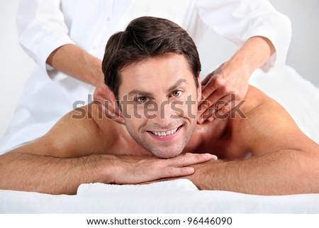 Man enjoying a back massage - stock photo
