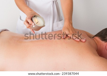 man enjoying an exotic massage with warm oil