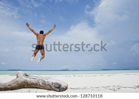 Man enjoying on the beach - stock photo
