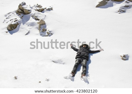 Man enjoying the outdoors in the winter time - stock photo