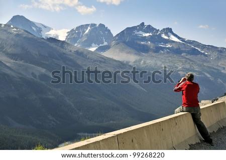 Man Enjoying View of the Canadian Rockies Jasper National Park Alberta Canada Horizontal - stock photo