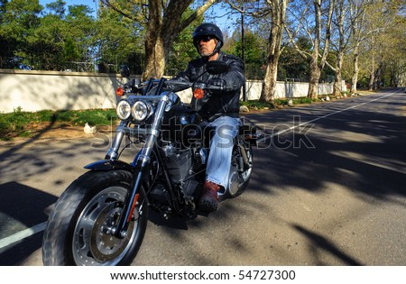Man enjoys his Sunday afternoon ride on his motorbike