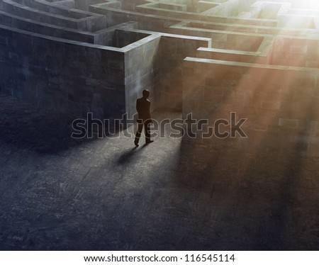 Man entering a mysterious maze - stock photo