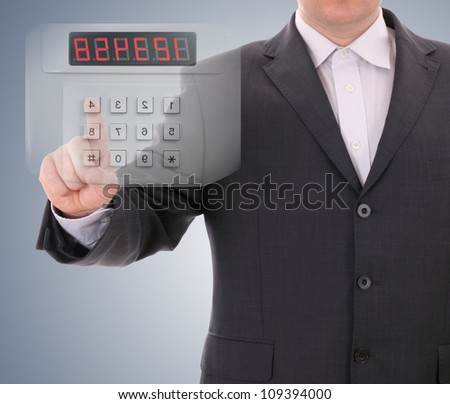 Man entering safe code - stock photo