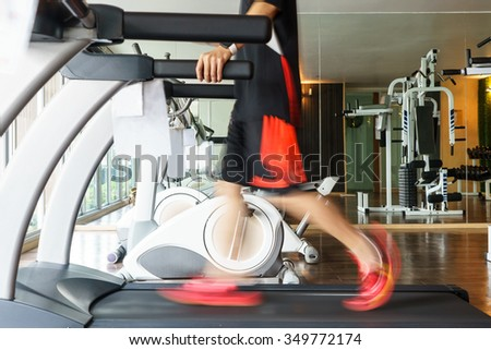 Man exercise on treadmill for healthy in fitness gym