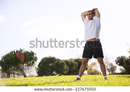 Man exercising at the city garden - stock photo