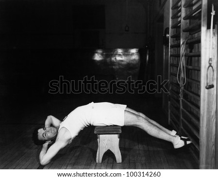 Man exercising on bench - stock photo
