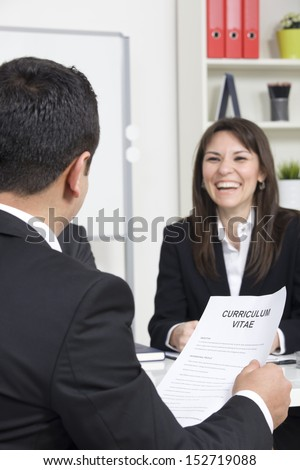 man explaining about his profile to business managers at a job interview - stock photo
