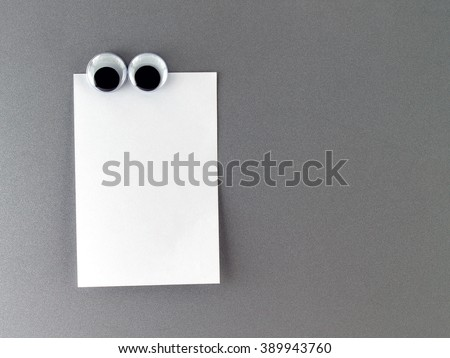 Man eyes Fridge Magnet and blank note for text input - stock photo