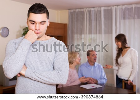 Man faced with misunderstanding family - stock photo