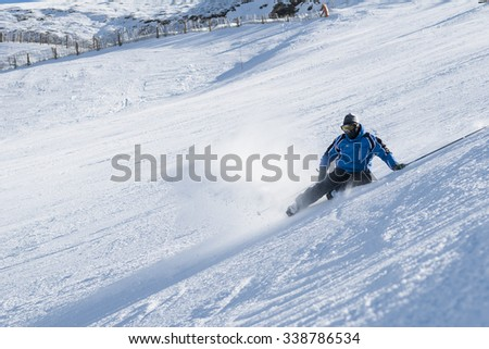 Man fall on the ski slopes at Andorra - stock photo