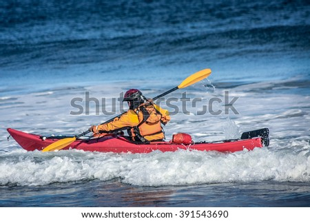 Man fighting the wave on kayak  on rough sea in Black Cove, Nova Scotia coast, Canada - stock photo
