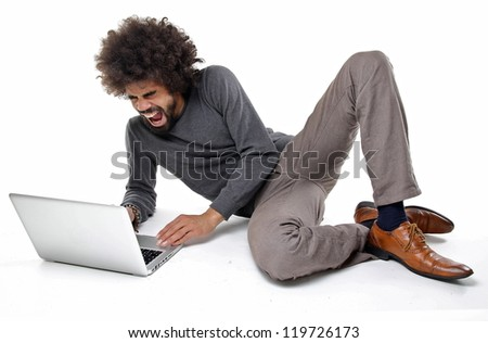 Man fighting with hist laptop