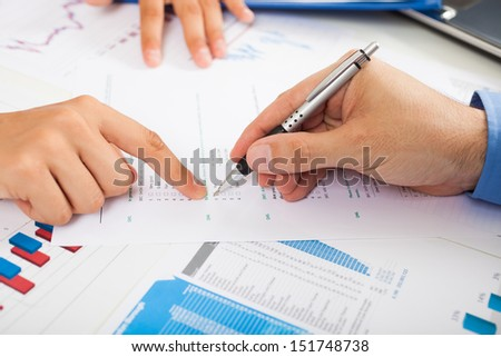 Man filling a quality survey with check boxes - stock photo