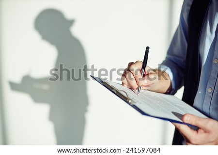 Man filling in document