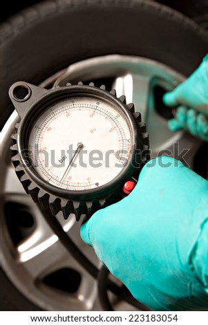 Man fills the wheel of a car - stock photo
