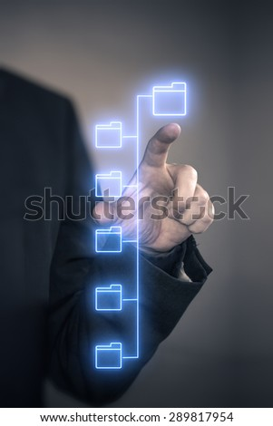 Man finger connecting to virtual folders - stock photo