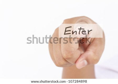 "Man finger push ""enter"" button - stock photo"