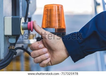 Man finger pushing rubber knob