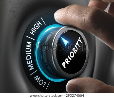 Man fingers setting priority button on highest position. Concept image for illustration of priorities management. - stock photo