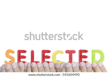 "Man fingers showing ""SELECTED"" text on white background"