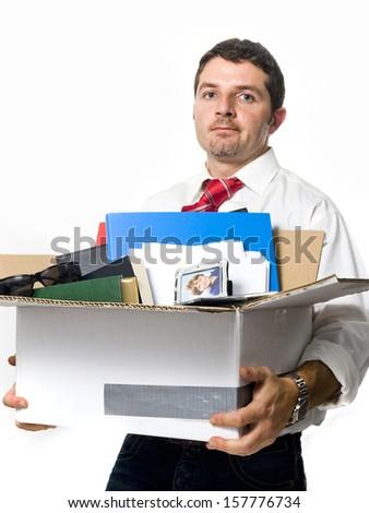 Man fired from job holding Stuff in Cardboard Box - stock photo