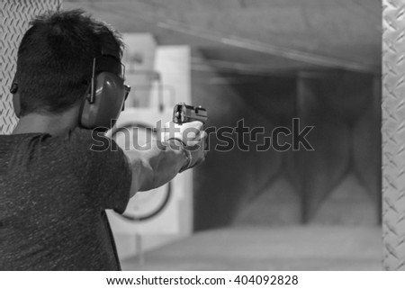 Man firing usp pistol target indoor stock photo 436844200 for Indoor shooting range design uk