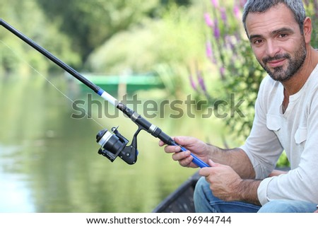 Man fishing - stock photo