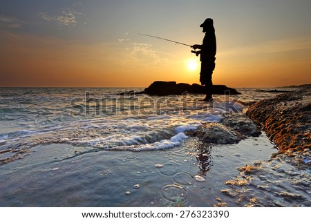 Man fishing at sunset in Rayong, Thailand - stock photo