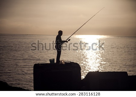 Man fishing at the morning. Beautiful sunrise. - stock photo