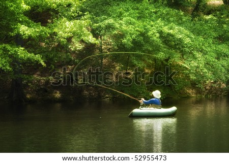 Man fishing in afternoon sunlight - stock photo