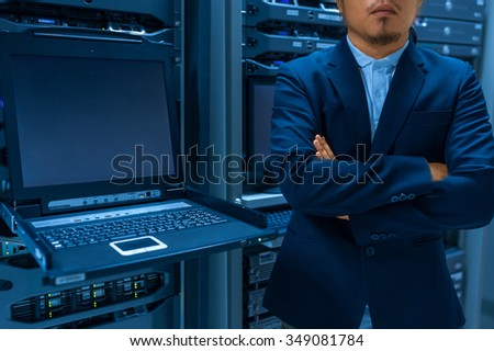 Man fix server network in data center room .