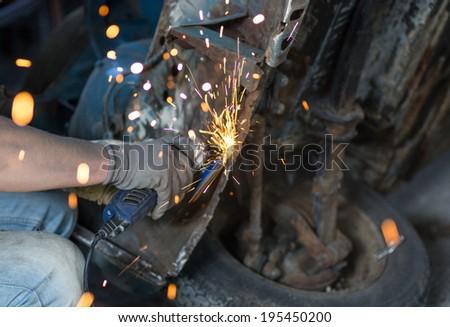 man fixing an old car - stock photo