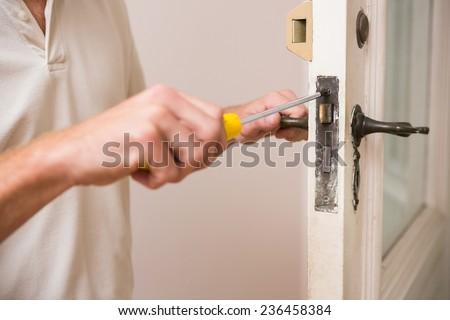 Man fixing the door handle with screwdriver in a new house & Door Repair Stock Photos Royalty-Free Images \u0026 Vectors - Shutterstock Pezcame.Com
