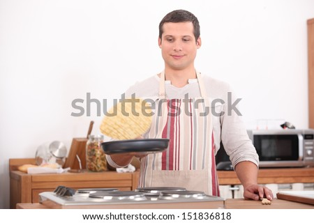 Man flipping pancake - stock photo