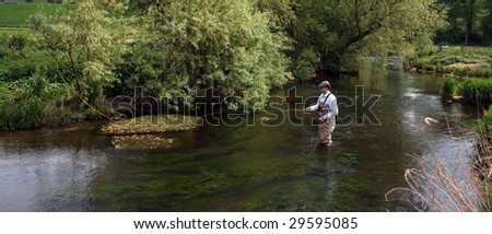 Man flyfishing the river Eden in Scotland - stock photo