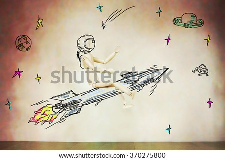 Man flying on the rocket into open space. Abstract image with a wooden puppet - stock photo