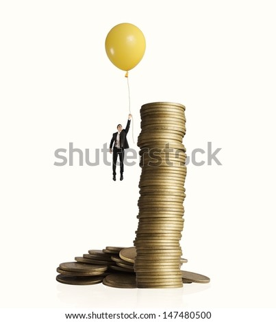 Man flying with balloon. concept of earning money - stock photo