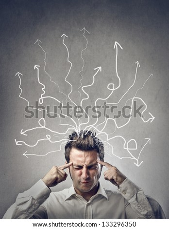 man focuses with closed eyes - stock photo