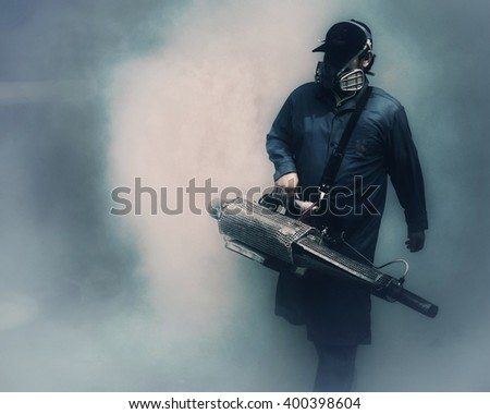 Man from health office holding smoke machine for inseck hunting - stock photo