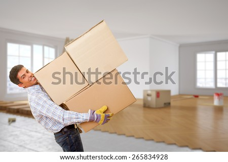 Man from moving company with many boxes in his hands